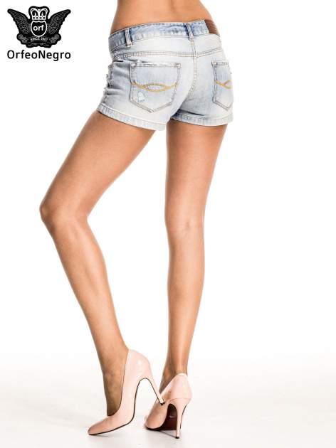 Jasnoniebieskie jeansowe szorty z wytarciami                                  zdj.                                  4