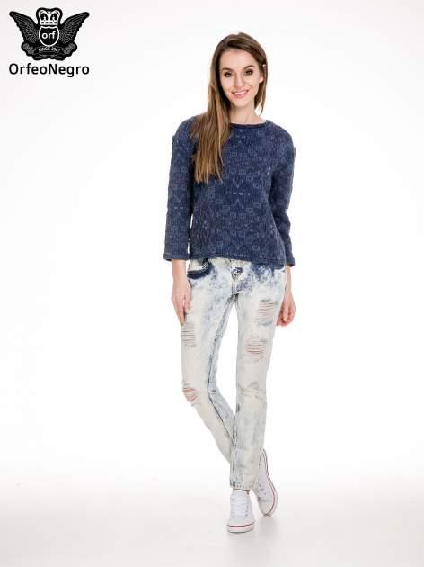 Jasnoniebieskie rozjaśniane spodnie jeansowe z przetarciami                                  zdj.                                  2