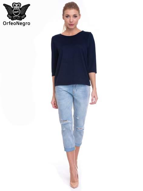 Jasnoniebieskie spodnie jeansowe 7/8  podwijaną nogawką                                  zdj.                                  2
