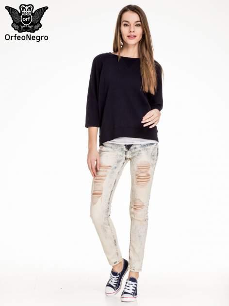 Jasnoniebieskie spodnie jeansowe rurki z rozdarciami                                  zdj.                                  4