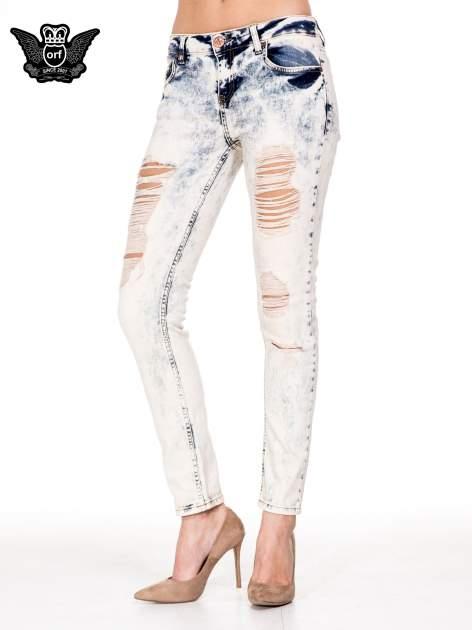 Jasnoniebieskie spodnie jeansowe rurki z rozdarciami                                  zdj.                                  1