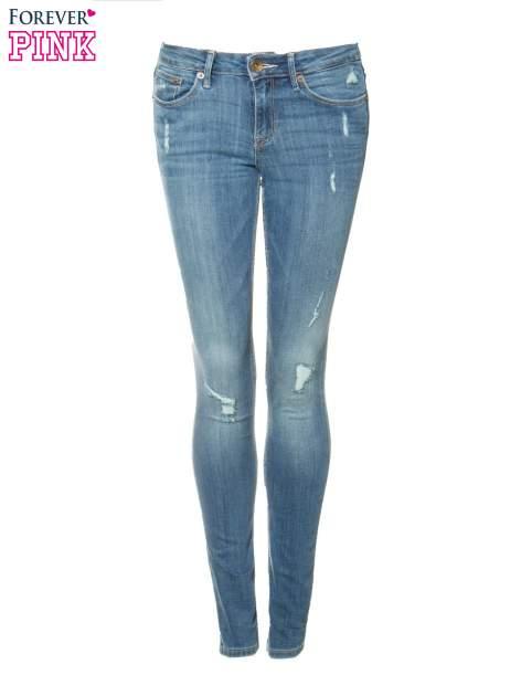Jasnoniebieskie spodnie jeansowe z przetarciami                                  zdj.                                  5