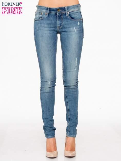 Jasnoniebieskie spodnie typu skinny jeans z przetarciami                                  zdj.                                  1
