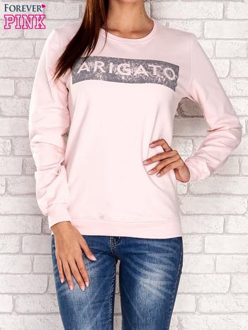 Jasnoróżowa bluza z napisem ARIGATO