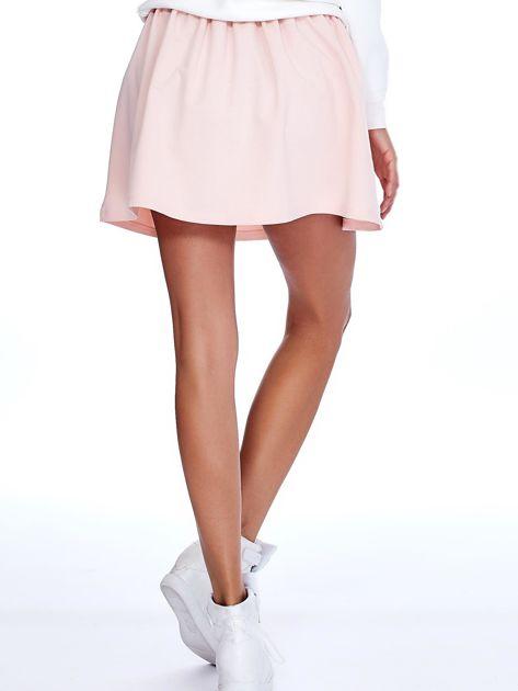Jasnoróżowa rozkloszowana dresowa spódnica Spódnica