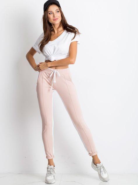 Jasnoróżowe spodnie dresowe Defined                              zdj.                              4