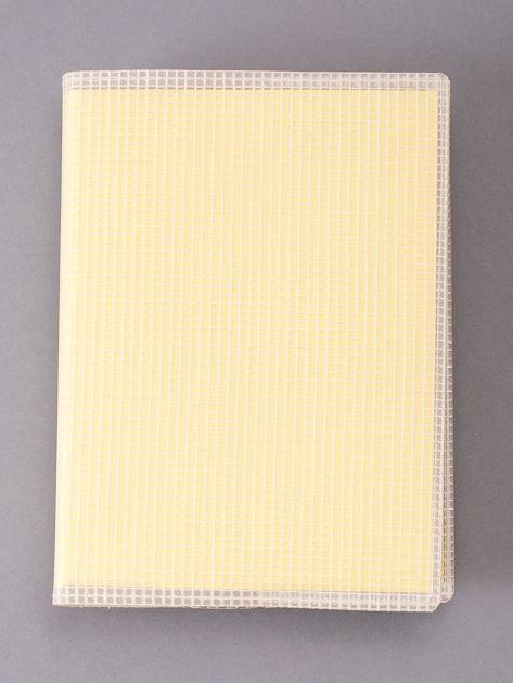 Jasnożółty notes w linie