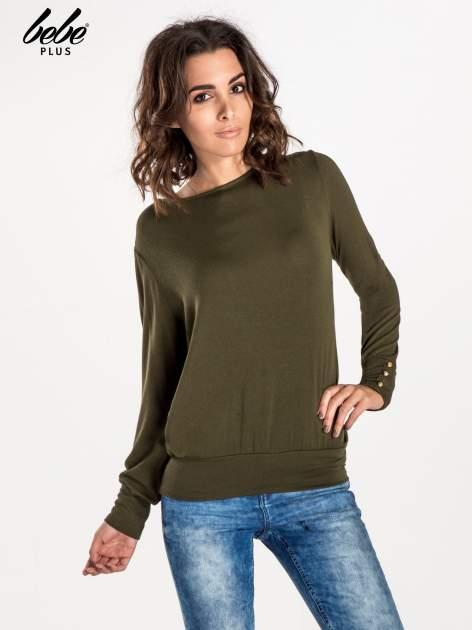 Khaki sweter z kokardą na plecach