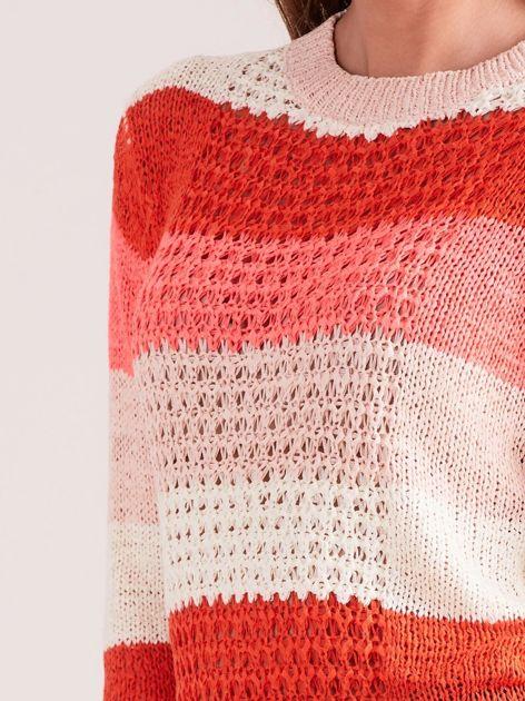 Koralowo-różowy sweter w pasy                              zdj.                              6