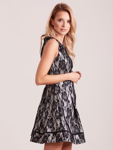 Koronkowa rozkloszowana sukienka czarna                              zdj.                              3