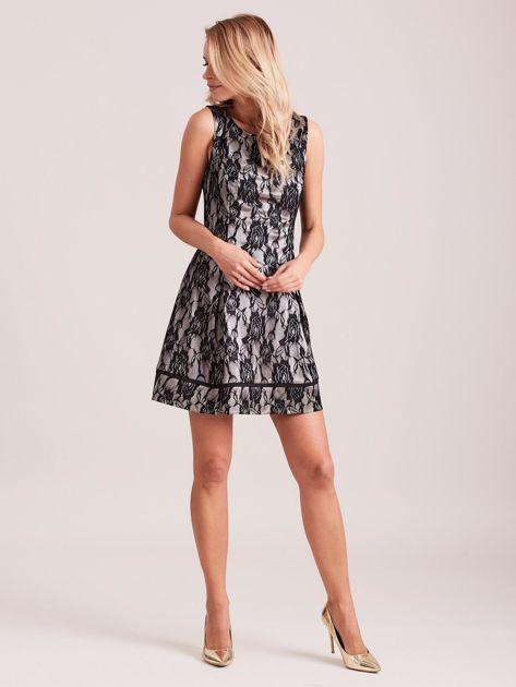 Koronkowa rozkloszowana sukienka czarna                              zdj.                              4
