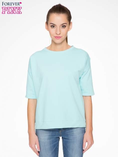 Miętowa bluza z suwakiem z tyłu