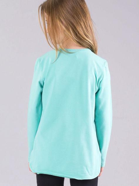 Miętowa bluzka dziewczęca z błyszczącą aplikacją                              zdj.                              2