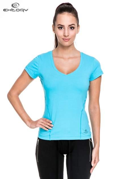 Niebieski damski t-shirt sportowy z modelującymi przeszyciami