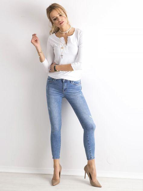 Niebieskie damskie spodnie jeansowe                               zdj.                              4