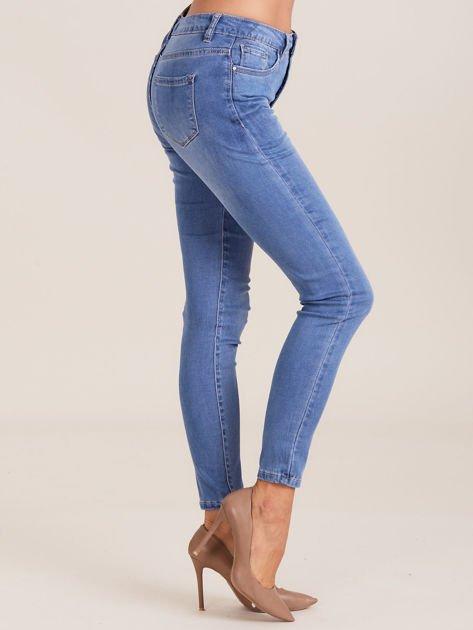 Niebieskie denimowe spodnie damskie                              zdj.                              3