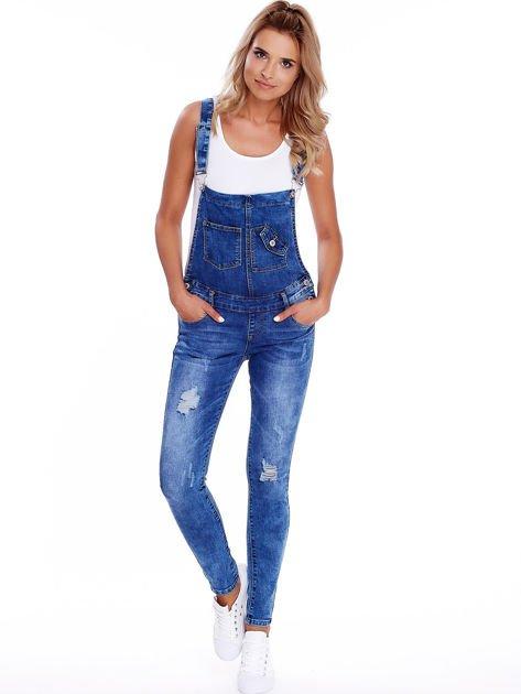 Niebieskie jeansowe ogrodniczki z przetarciami                              zdj.                              1