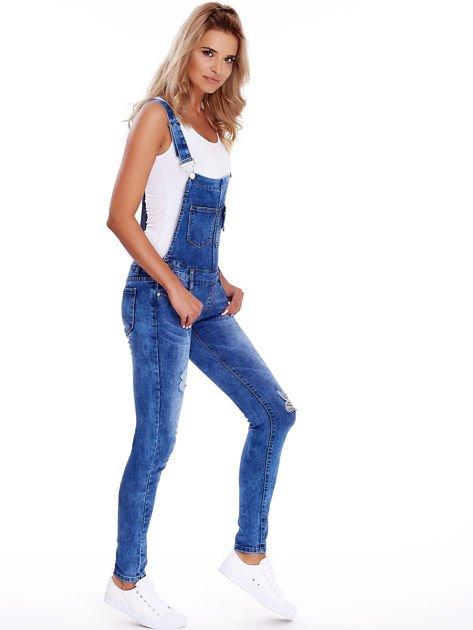 Niebieskie jeansowe ogrodniczki z przetarciami                              zdj.                              3