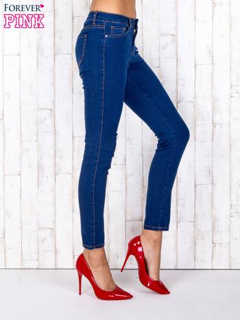 Niebieskie jeansowe spodnie skinny z kontrastowymi szwami                                  zdj.                                  2
