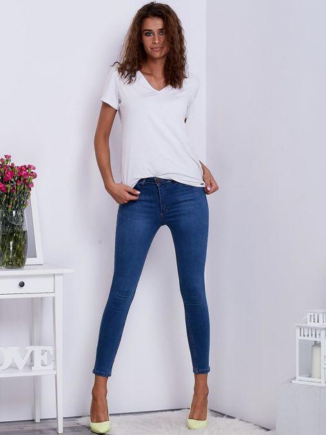 Niebieskie jeansowe spodnie ze stretchem                               zdj.                              4