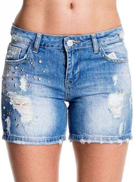 Niebieskie jeansowe szorty z dżetami                              zdj.                              1