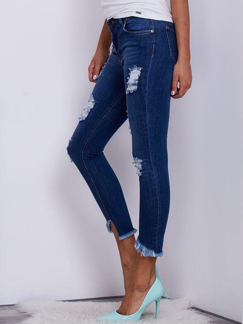 Niebieskie jeansy skinny z wystrzępieniami i przedarciami                              zdj.                              3