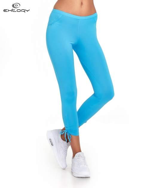 Niebieskie legginsy sportowe termalne z dżetami i ściągaczem