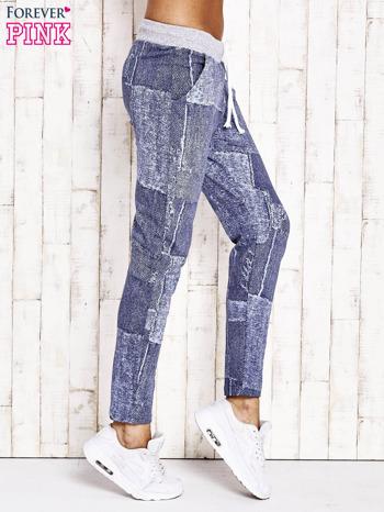Niebieskie ocieplane spodnie dresowe                                   zdj.                                  2
