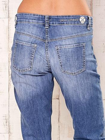 Niebieskie proste przecierane spodnie                                  zdj.                                  5