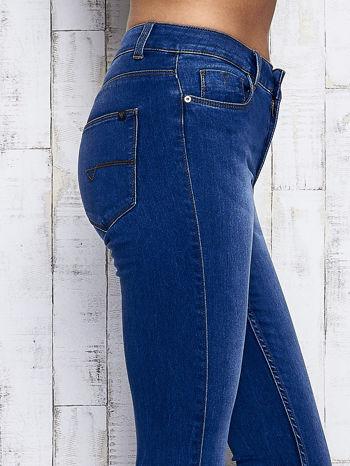 Niebieskie przecierane spodnie jeansowe                                   zdj.                                  5