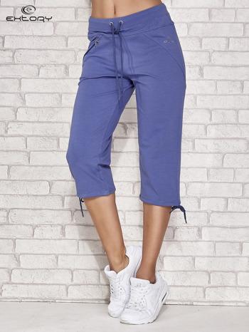 Niebieskie spodnie dresowe capri z kieszonką                                  zdj.                                  1