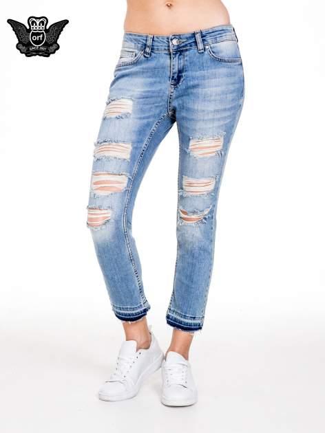 Niebieskie spodnie girlfriend jeans typu cut out                                  zdj.                                  1