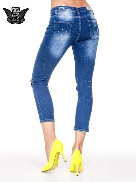 Niebieskie spodnie jeansowe długości 7/8 z łatami i przetarciami                              zdj.                              2