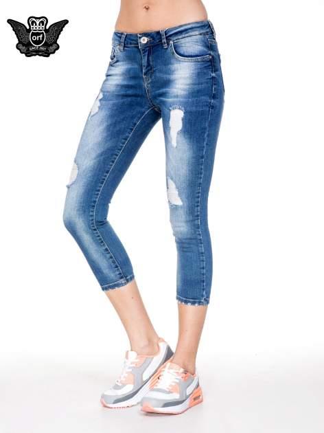 Niebieskie spodnie jeansowe do połowy łydki z przetarciami                                   zdj.                                  1
