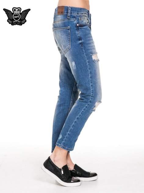 Niebieskie spodnie jeansowe rurki z dziurami i przetarciami                                  zdj.                                  3