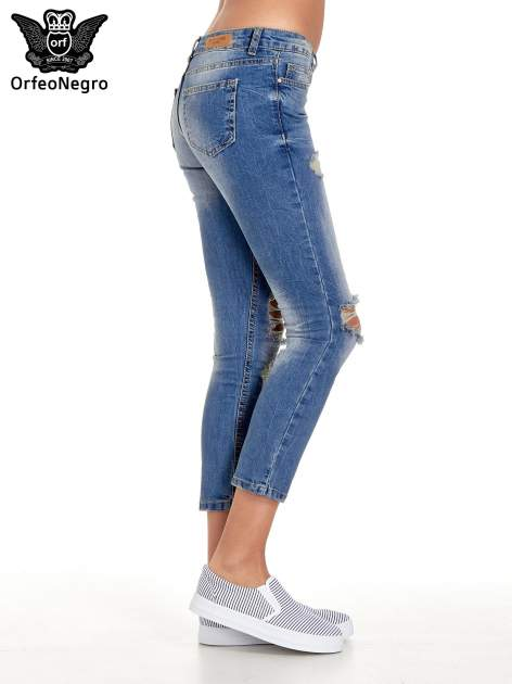 Niebieskie spodnie jeansowe skinny 7/8 z dziuarmi na kolanach                                  zdj.                                  3