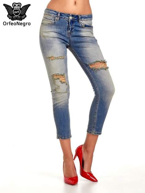 Niebieskie spodnie jeansowe skinny z dziurami