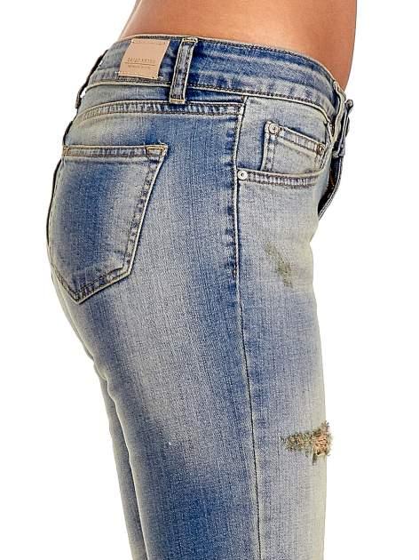 Niebieskie spodnie jeansowe skinny z dziurami                                  zdj.                                  6