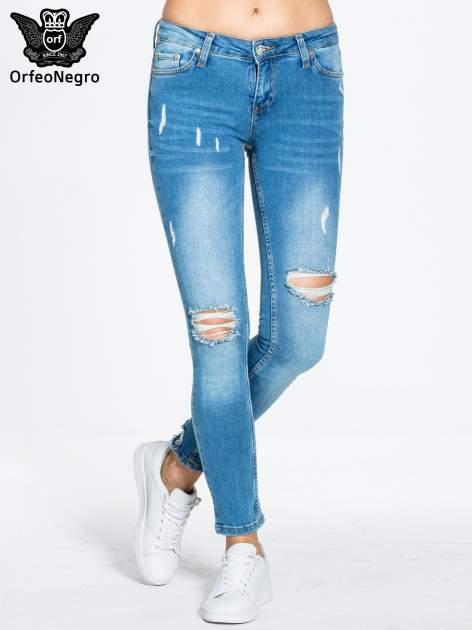 Niebieskie spodnie jeansowe skinny z dziurami                                  zdj.                                  1