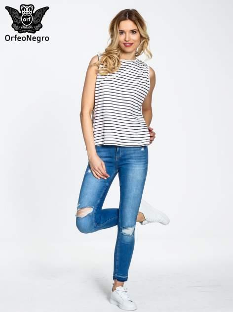 Niebieskie spodnie jeansowe skinny z dziurami na kolanach                                  zdj.                                  2