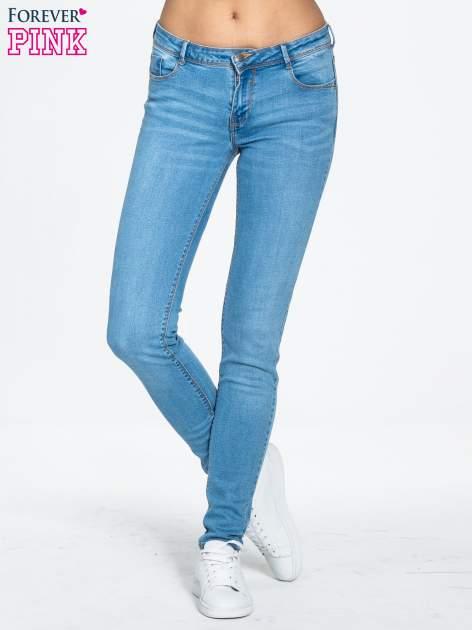 Niebieskie spodnie jeansowe super skinny