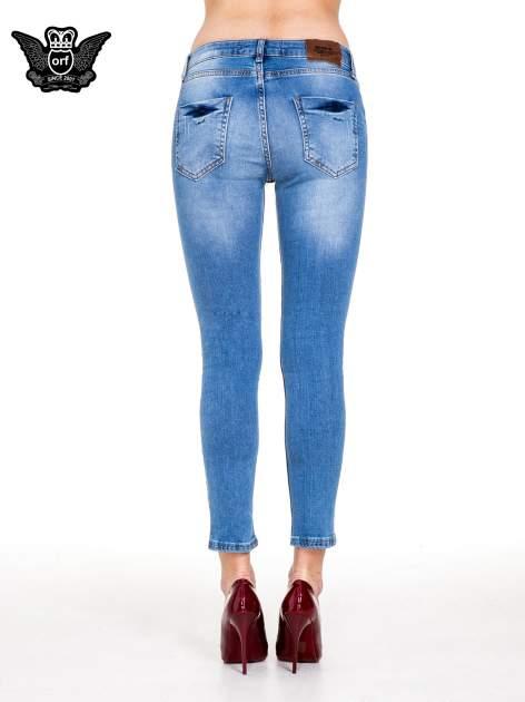 Niebieskie spodnie jeansowe z cieniowaną nogawką z przetarciami                                  zdj.                                  5