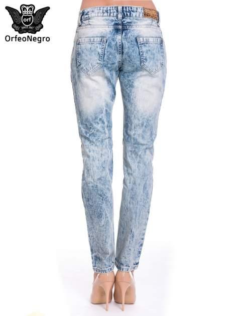 Niebieskie spodnie jeansowe z wytarciami                                  zdj.                                  5