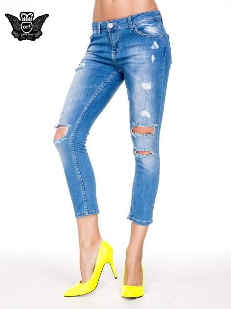 Niebieskie spodnie skinny jeans 7/8 z dziurami i przetarciami                                  zdj.                                  1