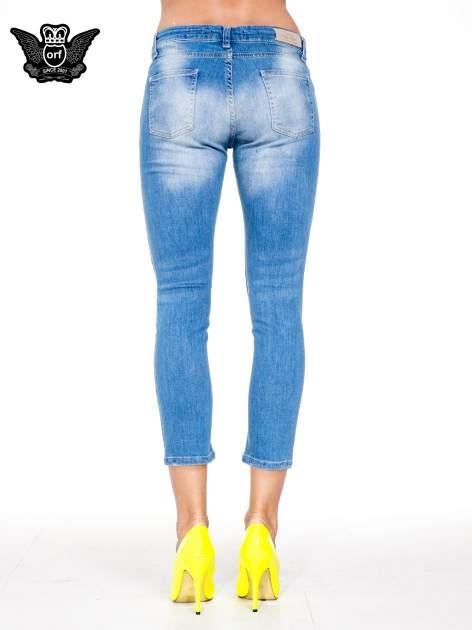 Niebieskie spodnie skinny jeans 7/8 z dziurami i przetarciami                                  zdj.                                  5