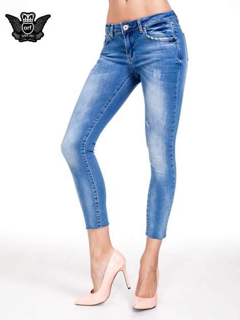 Niebieskie spodnie skinny jeans z cieniowaniem i ciętą nogawką                                  zdj.                                  1