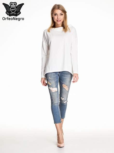 Niebieskie spodnie skinny jeans z koronkowymi łatami                                  zdj.                                  2