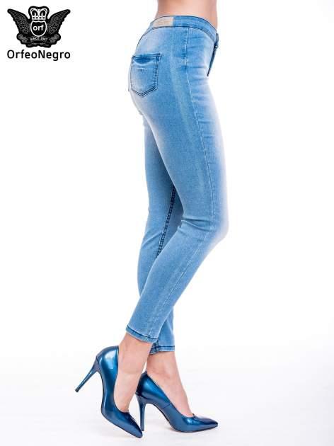 Niebieskie spodnie skinny jeans z wysokim stanem                                  zdj.                                  3
