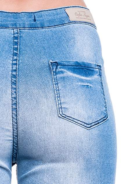 Niebieskie spodnie skinny jeans z wysokim stanem                                  zdj.                                  7