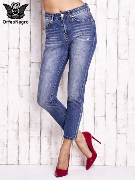 Niebieskie spodnie z przetarciami boyfriend jeans                                  zdj.                                  1